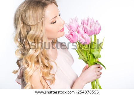 Young beautiful woman portrait with bouquet of tulip flowers