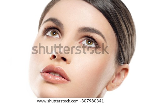 Young beautiful woman portrait with healthy skin studio on white - stock photo