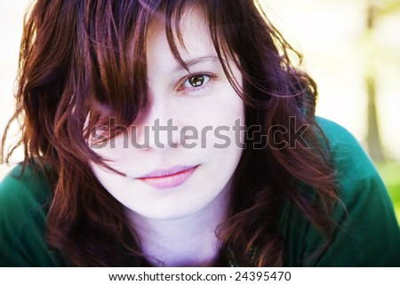 Young beautiful woman portrait with her hair on the wind. - stock photo