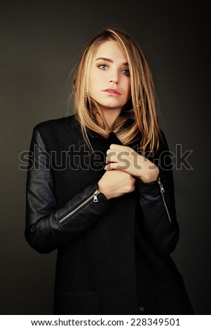 Young beautiful woman portrait with long hair in studio shot. Teen girl beautiful cheerful enjoying. Glamorous young woman in black leather jacket. - stock photo