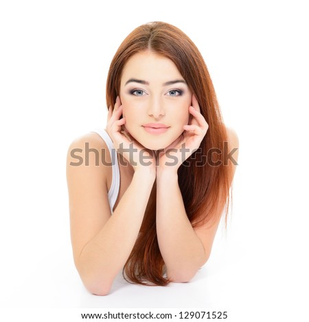 young beautiful woman portrait with long red hair over white studio shot - stock photo