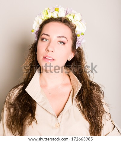 young beautiful woman portrait with wreath of flowers studio shot - stock photo