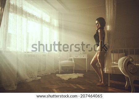 Young beautiful woman posing in hotel room - stock photo
