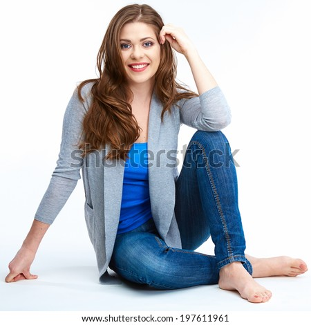 Young beautiful woman posing on white floor. Smiling female model full body. - stock photo
