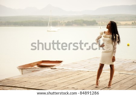 Young beautiful woman posing with summer dress - stock photo
