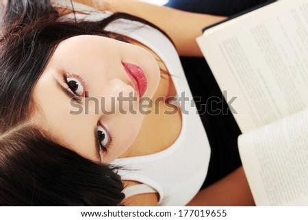Young beautiful woman reading book  - stock photo