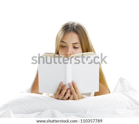 Young beautiful woman reading in bed, cover book is blank - stock photo