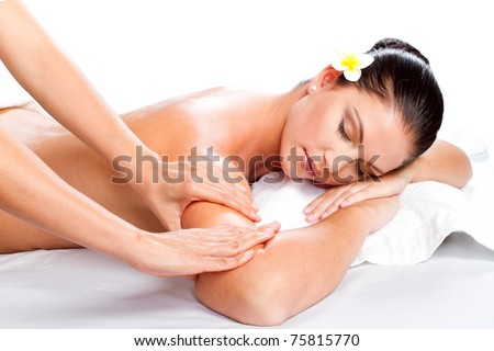 young beautiful woman receiving massage over white - stock photo