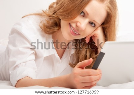 young beautiful woman relaxing at home with a Tablet PC - stock photo