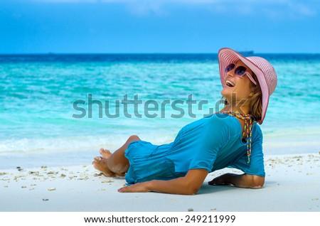 Young beautiful woman relaxing on a beach - stock photo