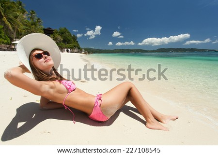 Young beautiful woman relaxing on the beach - stock photo