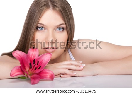 young beautiful woman relaxing with pink  flower at spa isolated on white background