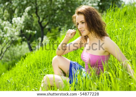 Young beautiful woman reverie in grass