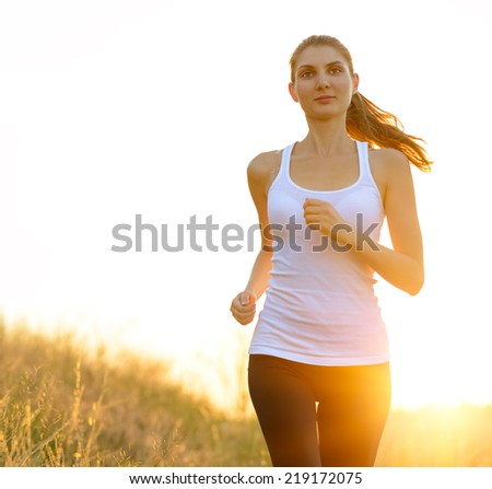 Young Beautiful Woman Running on the Trail in the Morning. Active Lifestyle - stock photo