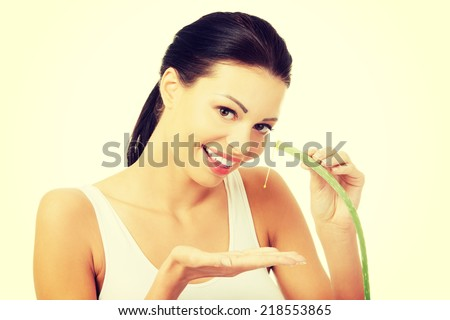 Young beautiful woman's face and aloe vera. Isolated on white background - stock photo