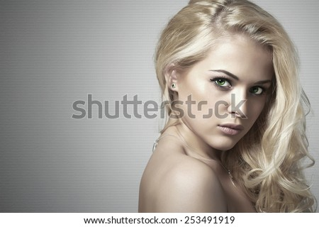 young beautiful woman.Sexy Blond girl. Gray Background.Your text here.Hairstyle - stock photo