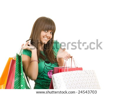 Young beautiful woman shopping with credit card in her hand isolated on white