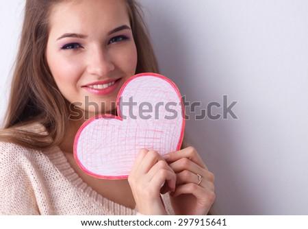 Young beautiful woman showing gift card.  - stock photo