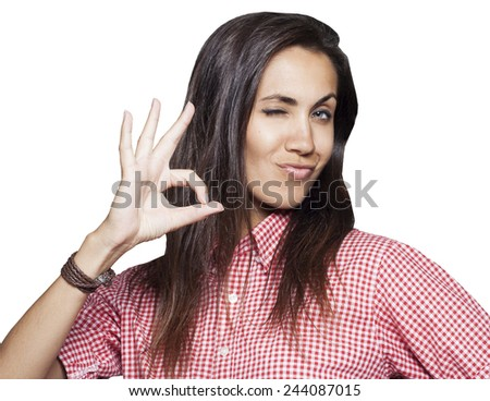 Young beautiful woman showing hand ok sign - stock photo
