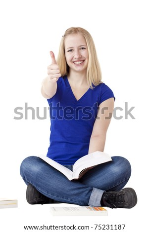 Young beautiful woman sits cross-legged and holds thumb up.Isolated on white background.