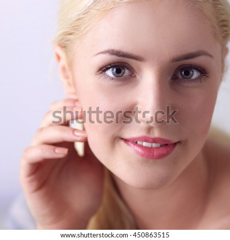 Young beautiful woman sitting on couch at her room - stock photo
