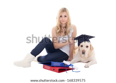 young beautiful woman sitting with dog in student hat isolated on white background - stock photo