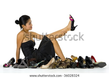 young, beautiful woman sitting with her shoes, isolated on white - stock photo