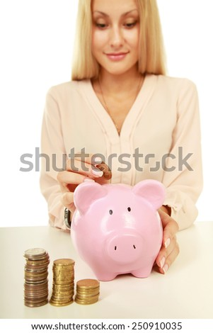 Young beautiful woman sitting with piggy bank ,money box, isolated on white background