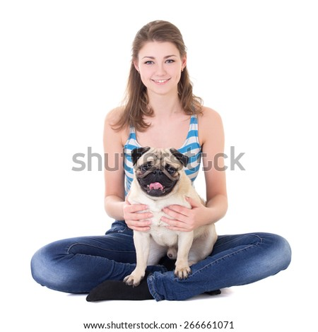 young beautiful woman sitting with pug dog isolated on white background - stock photo