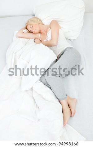 Young beautiful woman sleeping - stock photo