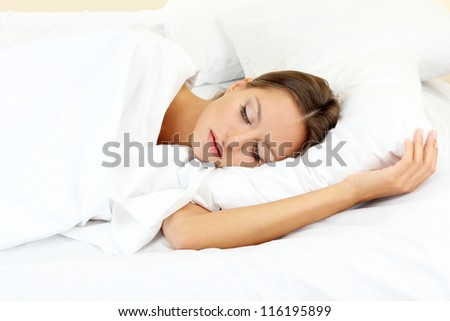 young beautiful woman sleeping in bed - stock photo