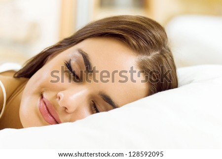 Young beautiful woman sleeping on bed
