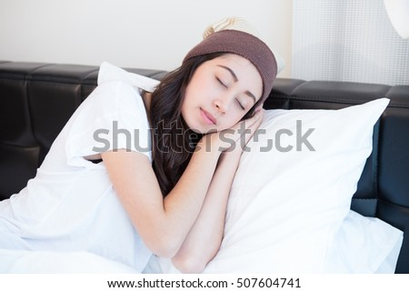 young beautiful woman sleeping on the bed.