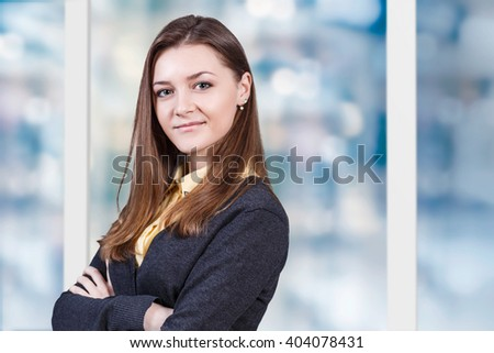 Young beautiful woman smiling - stock photo