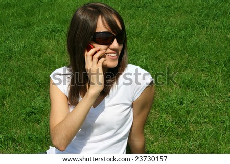 Young beautiful woman speaking by phone.