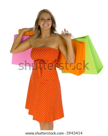 Young, beautiful woman standing and holding bags. Smiling and looking at camera. Isolated on white in studio. Hands up