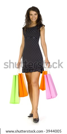 Young, beautiful woman standing and holding bags. Smiling and looking at camera. Isolated on white in studio, whole body