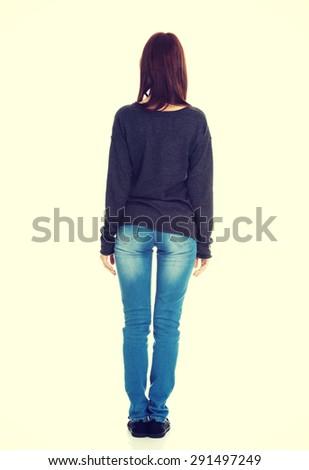 Young beautiful woman standing backside - stock photo