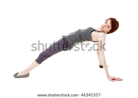 Young beautiful woman standing in yoga position, isolated on white background.