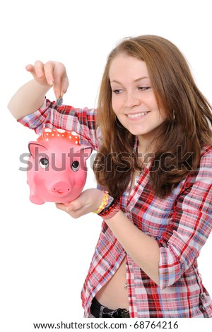 Young beautiful woman standing with piggy bank (money box), isolated on white background - stock photo