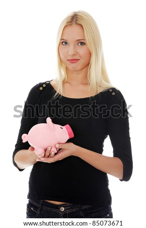 Young beautiful woman standing with piggy bank (money box), isolated on white background