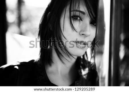 Young beautiful woman staring at camera. - stock photo