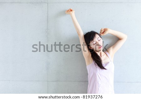 Young beautiful woman stretching - stock photo