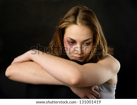 Young beautiful woman suffering from a severe depression - stock photo