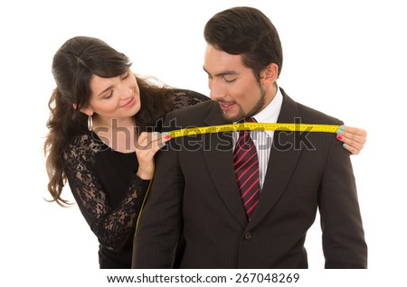 young beautiful woman tailor designer taking measures of male client's chest isolated on white - stock photo