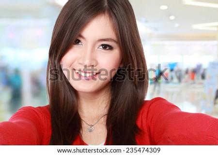 young beautiful woman taking selfie using mobile phone - stock photo
