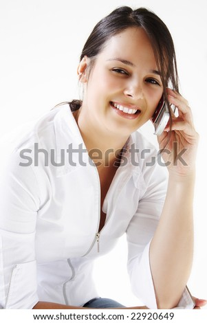 Young beautiful woman talking and smiling on cellphone.