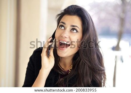 Young beautiful woman talking on cell phone  - stock photo