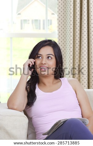 Young beautiful woman talking on mobile phone