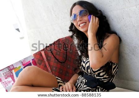 Young beautiful woman talking on phone - stock photo